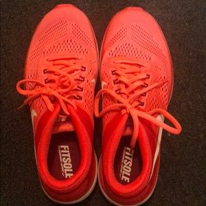 Coral and white nikes